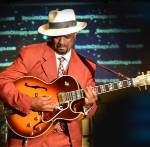 Nick Colionne playing guitar